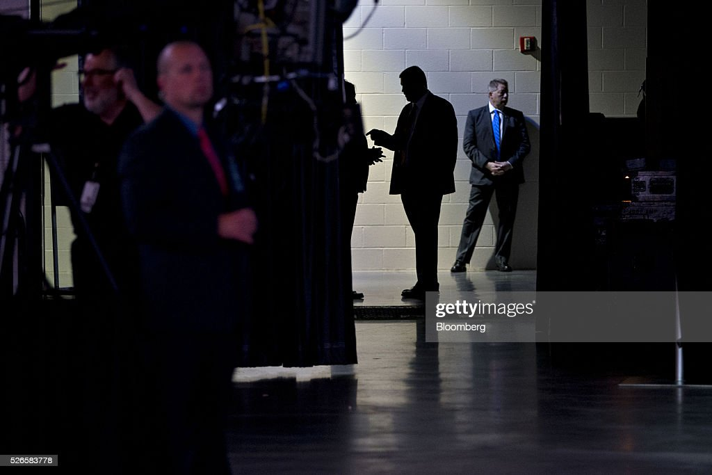 Security guards stand in a backstage entrance ahead of the Berkshire Hathaway Inc. annual shareholders meeting in Omaha, Nebraska, U.S., on Saturday, April 30, 2016. Dozens of Berkshire Hathaway Inc. subsidiaries will be showing off their products as Chief Executive Officer Warren Buffett hosts the company's annual meeting. Photographer: Daniel Acker/Bloomberg via Getty Images