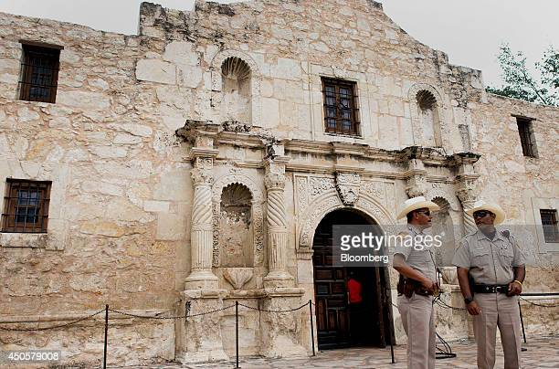 Security guards stand in front of the Alamo in downtown San Antonio Texas US on Tuesday June 3 2014 Localities in Texas home to seven of the nation's...
