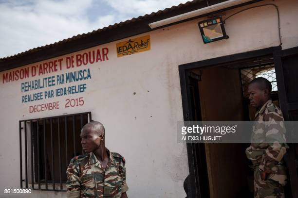Security guards stand in front of the Bouar detention centre in Bouar western Central African Republic on October 13 2017 In the Central African...