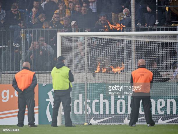 Security guards stand infront of the Dresden supporters after the Second Bundesliga match between Dynamo Dresden and Arminia Bielefeld at...