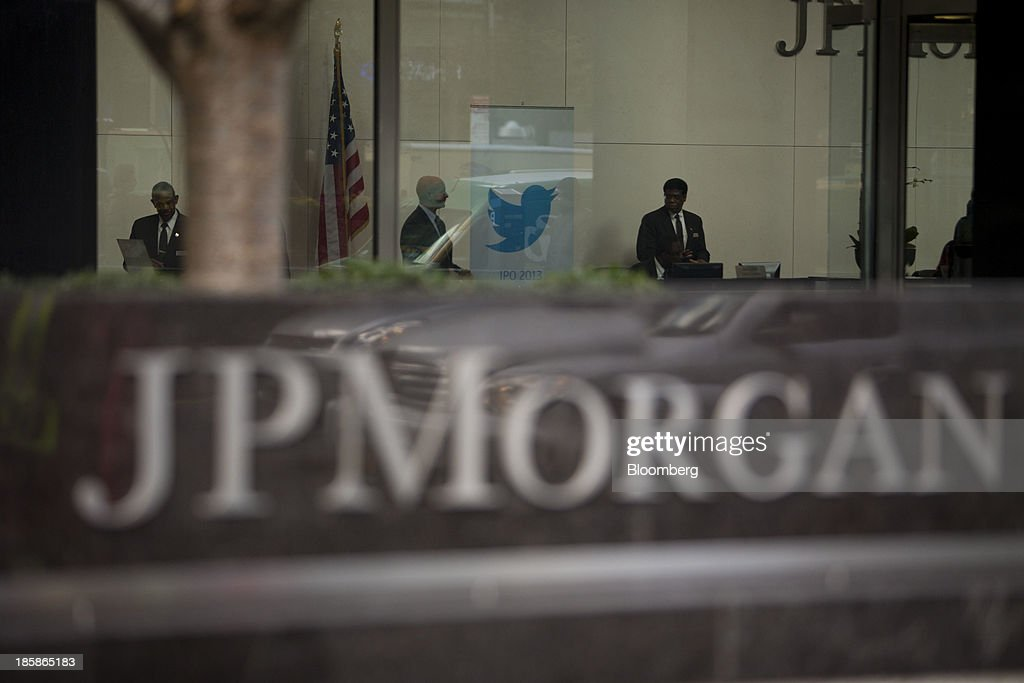 Security guards stand next to the Twitter Inc. logo displayed in the lobby of JPMorgan Chase & Co. headquarters in New York, U.S., on Friday, Oct. 25, 2013. Twitter Inc. will make the case to potential investors in its initial public offering that it needs to keep spending to grow, and profit will come once it can reap the benefits of those investments. Photographer: Scott Eells/Bloomberg via Getty Images