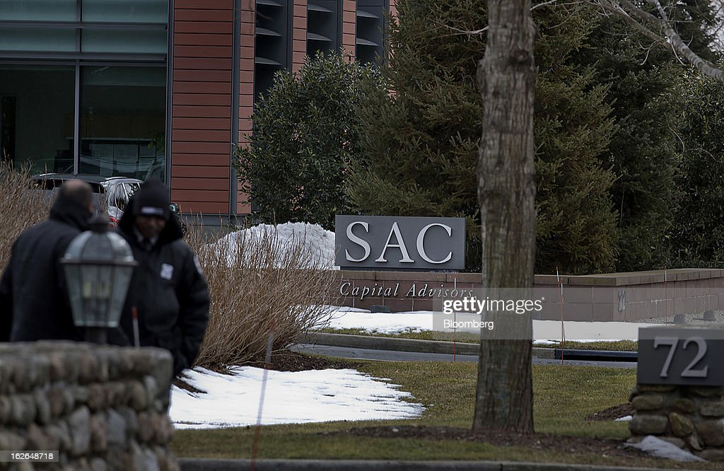 Security guards stand outside of SAC Capital Advisors LP headquarters in Stamford, Connecticut, U.S., on Friday, Feb. 22, 2013. U.S. investigators have subpoenaed a 2011 deposition of SAC Capital Advisors LP founder Steven Cohen, whose sworn statements on insider-trading compliance may hurt him as he tries to persuade regulators not to file a lawsuit with the potential to shut his $14 billion firm. Photographer: Victor J. Blue/Bloomberg via Getty Images