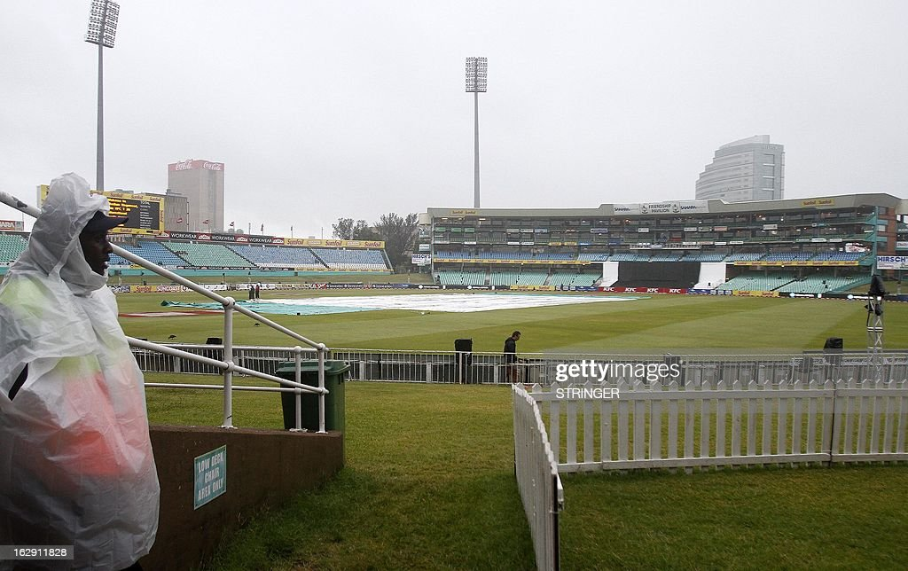 Security guards stand under the rain on March 1, 2013 at Sahara Stadium in Durban, South Africa. Steady rain threatened to wash out the first Twenty20 international between South Africa and Pakistan at Kingsmead here on Friday.