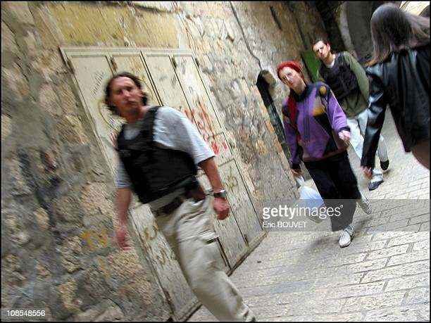 Security guards taking care of a Jewish women on the street in Jerusalem Israel in March 2002