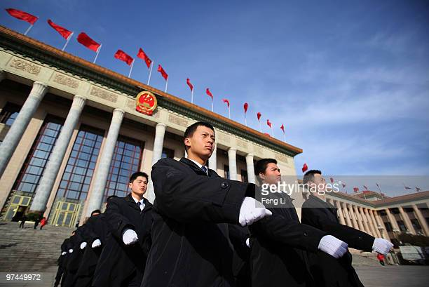 Security guards walk out the Great Hall of the People during the opening ceremony of the National People's Congress on March 5 2010 in Beijing China...