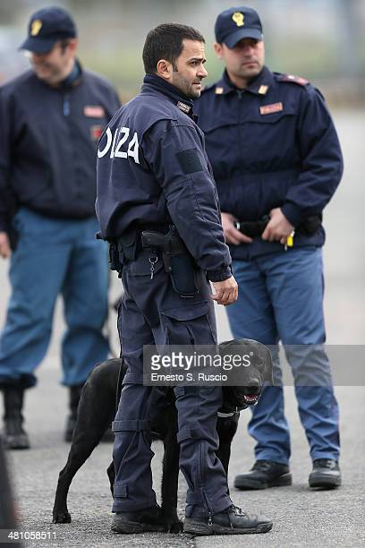 Security guards watch over the departure of US President Barack Obama at Fiumicino Airport on March 28 2014 in Rome Italy Obama is on a weeklong trip...