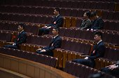 Security guards watch the closing ceremony of the Chinese People's Political Consultative Conference an advisory body to the legislature the National...