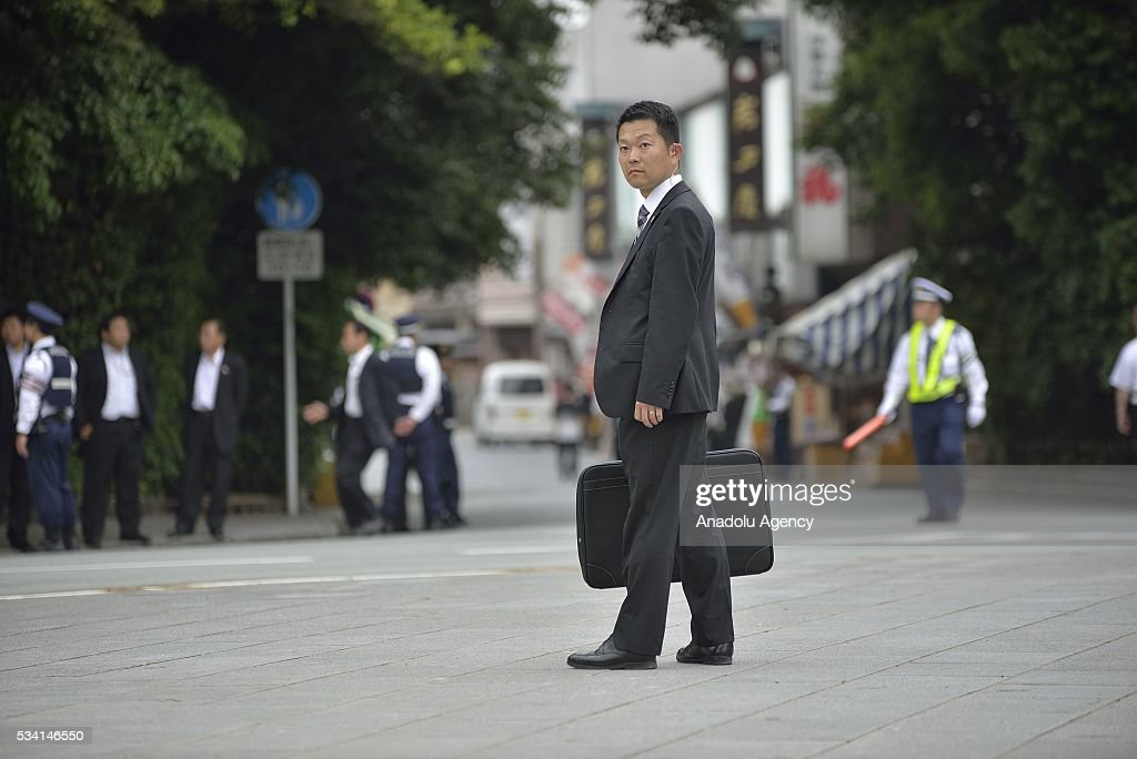Security guards with a bullet proof suitcase prepares the Prime Minister Shinzo Abes arrival at the Ise Jingu (Shrine) on May 25, 2016 in Ise, Mie Prefecture, Japan on May 25, 2016.