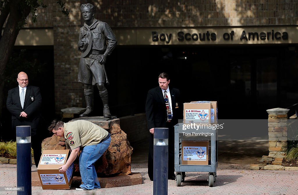 Security guards with the Boy Scouts of America look on as Jennifer Tyrrell, former Cub Scout Den Mother, delivers boxes containing 1.4 million signatures urging the Boy Scouts of America to reverse the organization's ban on LGBT Scouts on February 4, 2013 in Irving, Texas. The BSA national council announced they were considering to leave the decision of inclusion of gays to the local unit level. U.S. President Barack Obama urged the organization to end a ban on gays.