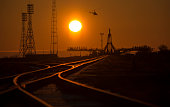 A security helicopter is seen surveying the launch pad area ahead of the Soyuz TMA16M spacecraft arrival by train on Wednesday March 25 in Baikonur...