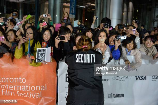 Security holds back fans at the 'Cold Eyes' premiere during the 2013 Toronto International Film Festival at Roy Thomson Hall on September 13 2013 in...