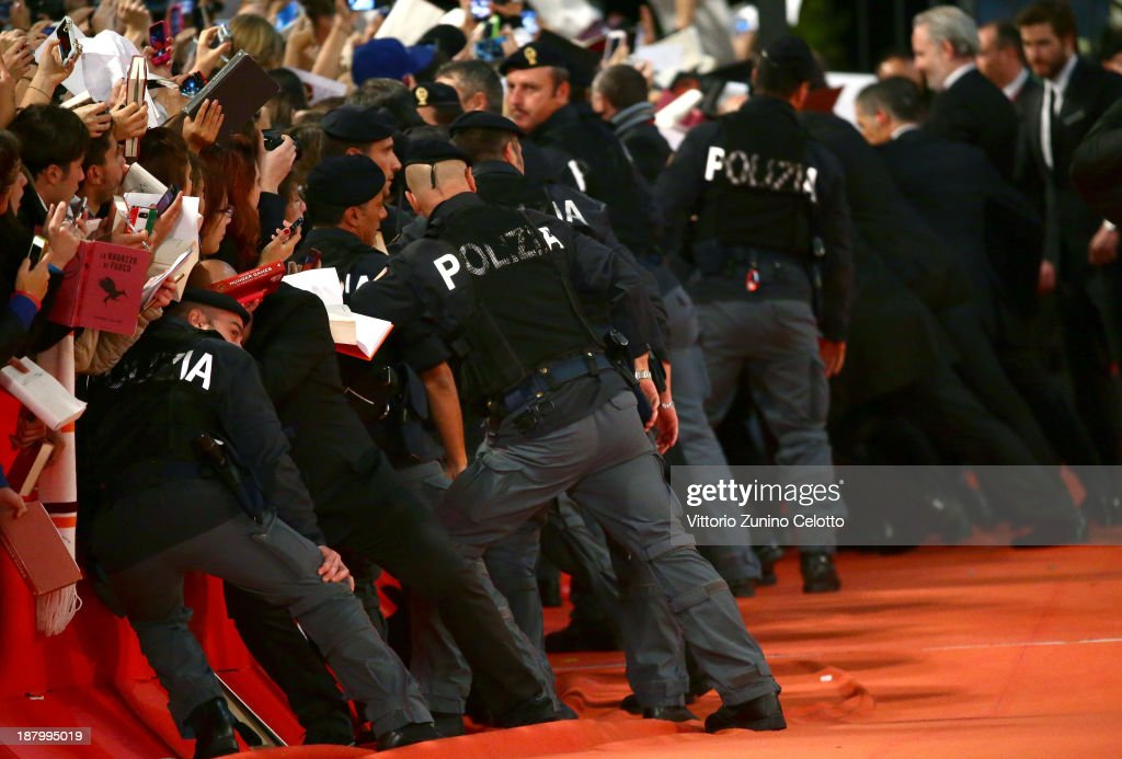 Security holds back the crowd at the 'The Hunger Games: Catching Fire' Premiere during The 8th Rome Film Festival at Auditorium Parco Della Musica on November 14, 2013 in Rome, Italy.