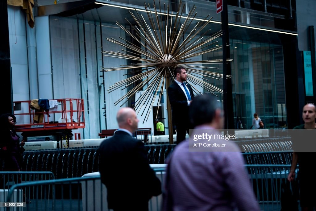 Security is seen as people walk along city streets during the 72nd session of the United Nations General Assembly September 19, 2017 in New York City.