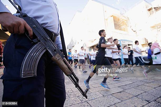 Security is seen at the start of the Right to Movement Marathon in the West Bank city of Bethlehem on April 1 2016 in Bethlehem West Bank Thousands...