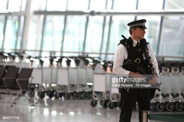 Security is tight as Britain's Queen Elizabeth II opens the 43 billion new Terminal 5 at Heathrow Picture date Friday March 14 2008 The official...