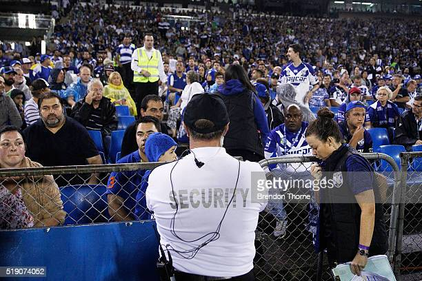 Security look on after a bottle was thrown from the crowd during the round five NRL match between the Canterbury Bulldogs and the Canberra Raiders at...