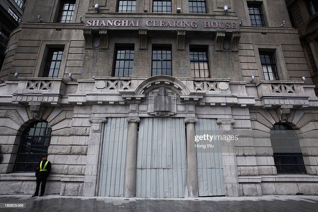 A security man guards beside a closed building at the Bund on February 3, 2013 in Shanghai, China.