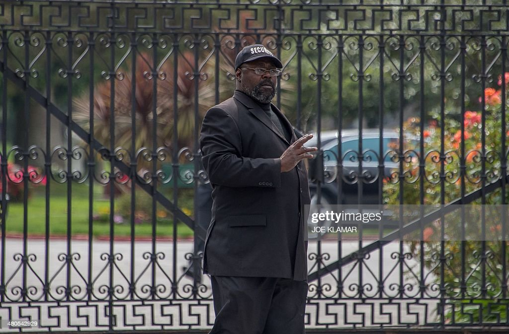 A security man guards the main gate of Hollywood Forever Cemetery during the funeral of Mick Jagger's girlfriend LWren Scott in Hollywood, California on March 25, 2014. The model-turned-fashion designer was found hanged in her luxury New York apartment last week. She was 49. The cemetery was closed for the roughly one-hour service, held amid tight security.