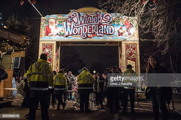 A security marshals check people's bags on entry to the Winter Wonderland in Hyde Park on December 21 2016 in London England Winter Wonderland is an...