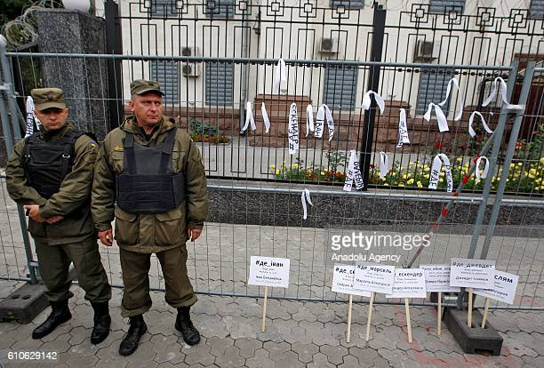 Security measures are taken as ribbons and placards with the names of the missing and murdered in the Crimea are seen during a protest of Crimean...
