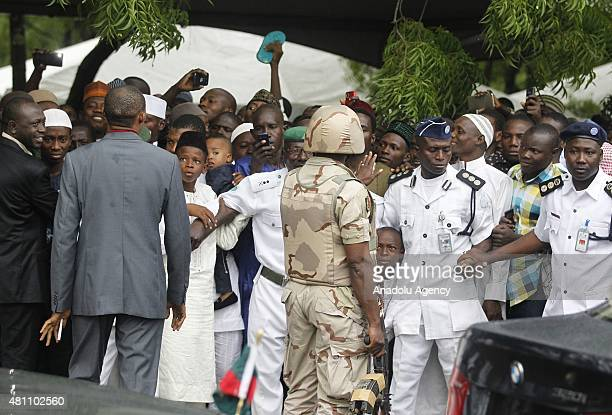 Security measures are taken as the Nigerian president Muhammadu Buhari arrives at Abuja National Mosque for the prayer on July 17 to observe the Eid...