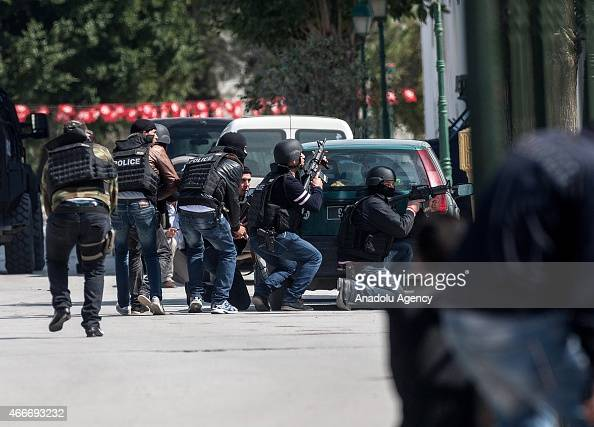 Security measures are taken outside the National Bardo Museum near the country's parliament in Tunis when gunmen take an unknown number of tourists...