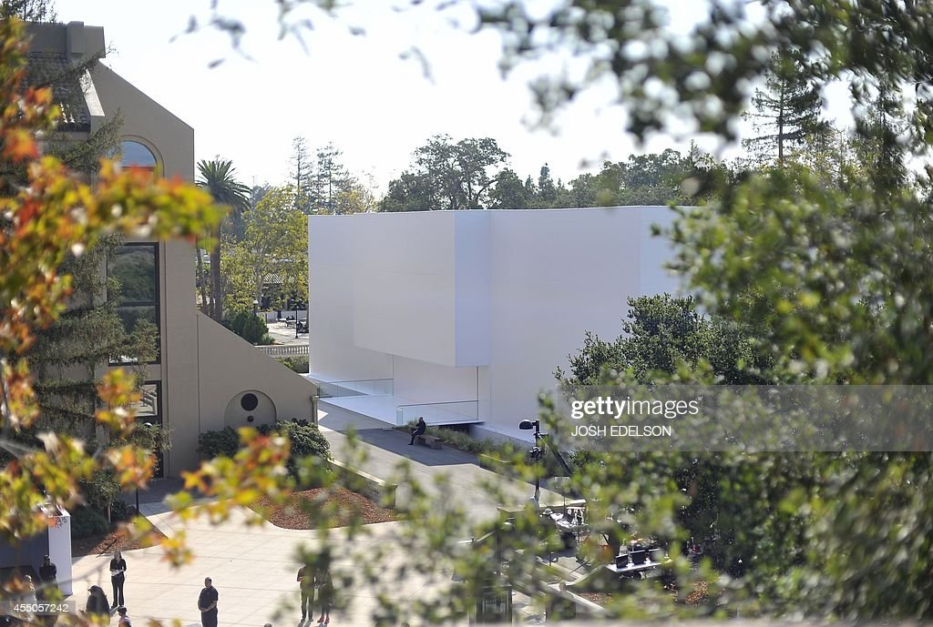Security members guard a mysteriously unmarked windowless white building before the start of an Apple product launch event September 9 in Cupertino...