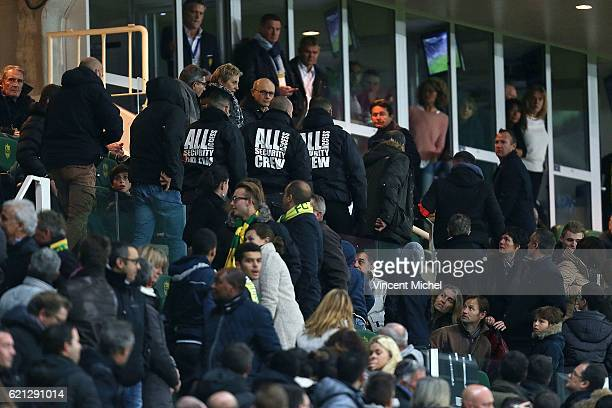 Security members protect Nantes' President Waldemar Kita during the Ligue 1 match between Fc Nantes and Toulouse Fc at Stade de la Beaujoire on...