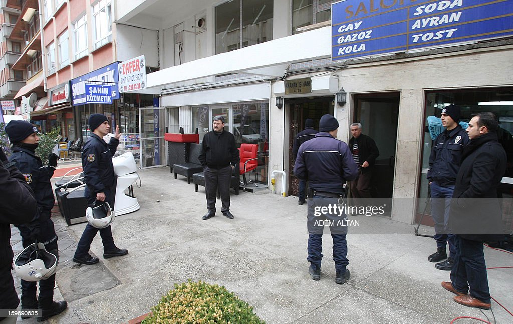 Security members stand outside the Conpemporary Lawyers' Association during a police search inside the building on January 18, 2013 in Ankara. Turkish police launched a major nationwide crackdown today against a banned left-wing group, arresting 85 people, among them 15 attorneys, local media reported. The dawn raids in Istanbul, Ankara, Izmir and other cities targeted the Revolutionary People's Liberation Front (DHKP-C), a Marxist group held responsible for several acts of terror in Turkey since the late 1970s.