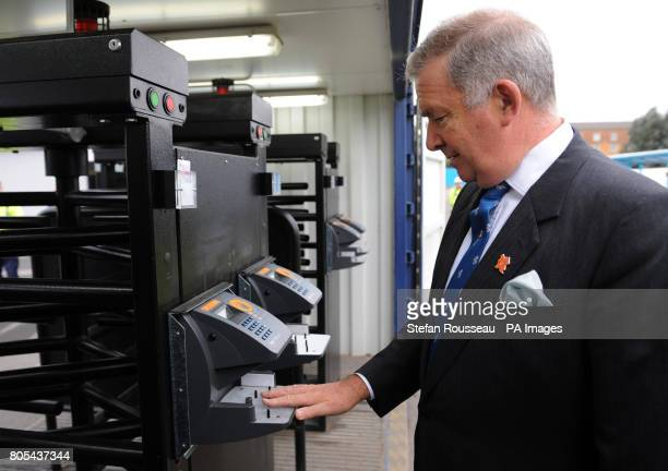 Security Minister Admiral Lord West try out new biometric entrance systems for construction workers at the Olympic Park in east London today