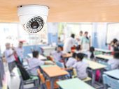 CCTV Security monitoring student in classroom at school.Security camera surveillance for watching and protect group of children while studying.
