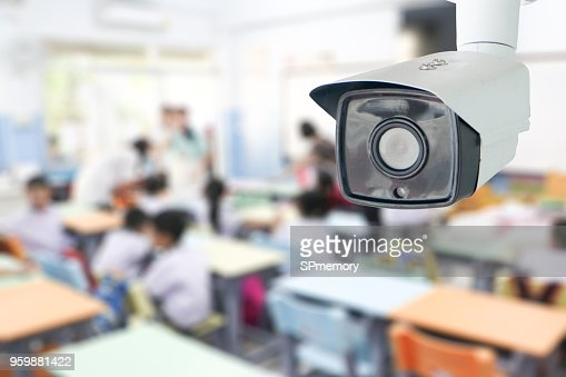 CCTV Security monitoring student in classroom at school.Security camera surveillance for watching and protect group of children while studying. : Foto de stock