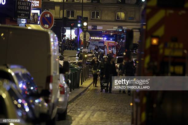 Security moves people along Rue Bichat following a string of attacks in the French capital Paris on November 13 2015 At least 18 people were killed...