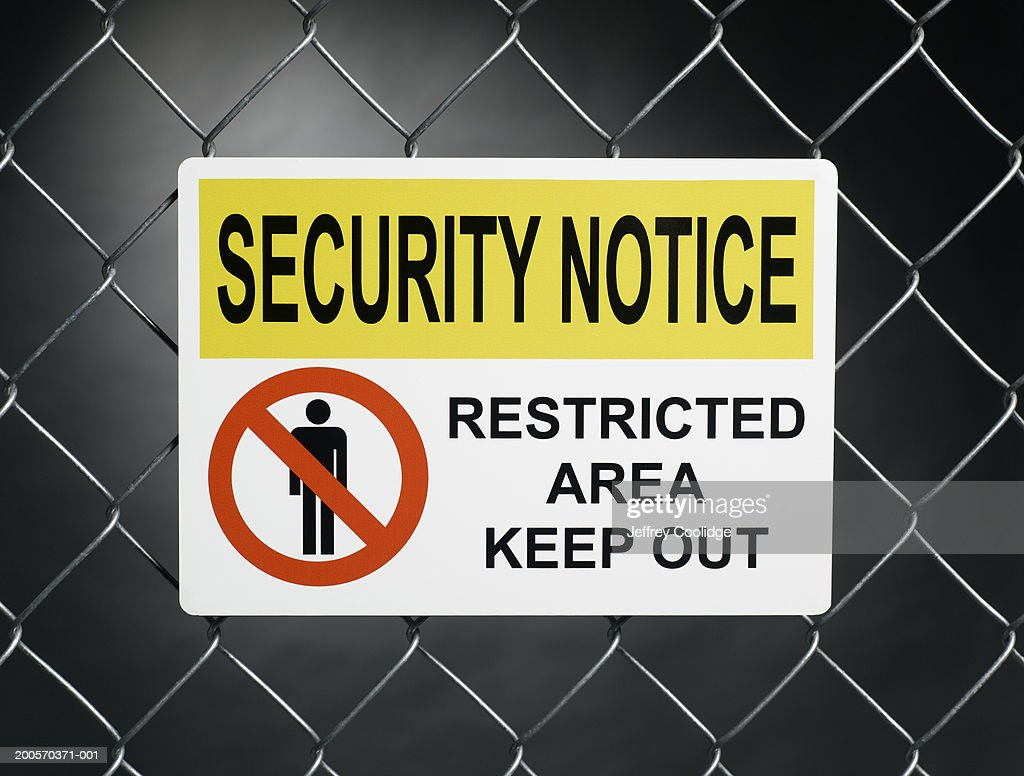 'Security notice, restricted area keep out' sign on fence