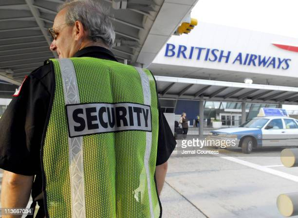 A security officer at the British Airways Terminal at John F Kennedy Airport directs passangers and vehicular traffic to maintain order at the...