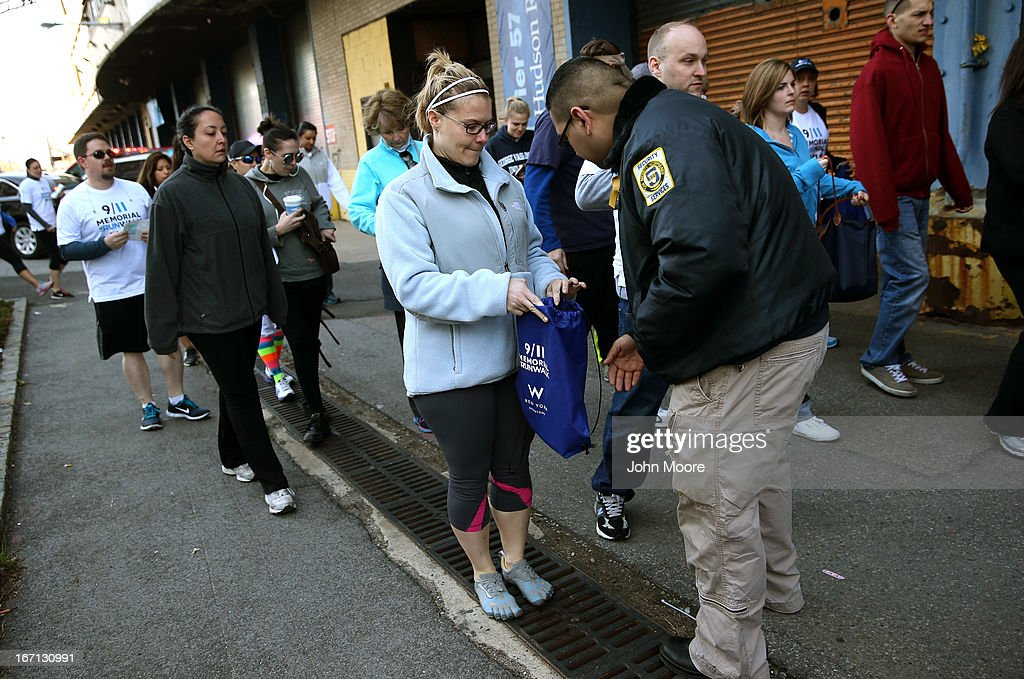 A security officer checks a runner's bag ahead of the 9/11 Memorial 5K Run/Walk on April 21, 2013 in New York City. Security was tight for the race, as has been the case in large scale events around the country since the Boston Marathon bombings. April 21 marks the anniversary that President Barack Obama signed into law legislation making 9/11 a day of service and volunteerism in memory of the victims of the 2001 attacks.