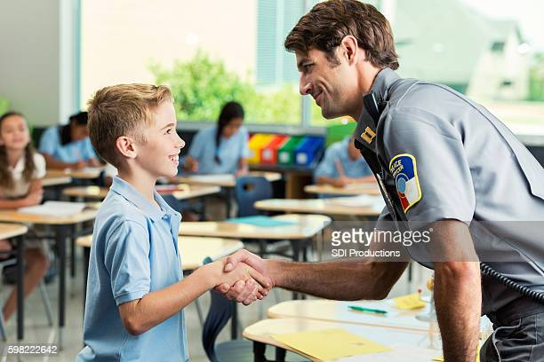Security officer greets elementary age private school student