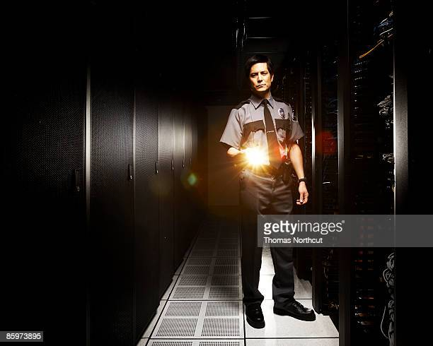 Security officer inside of server room.