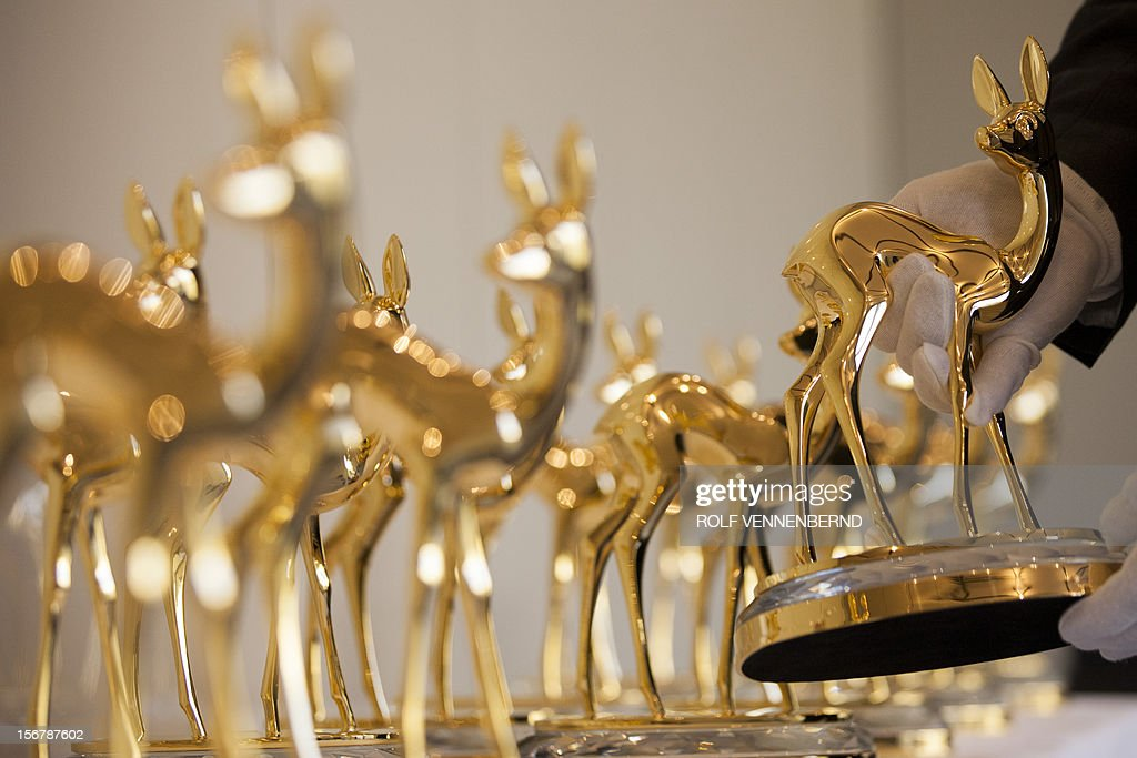 A security officer inspects Bambi trophies in Duesseldorf, western Germany, on November 21, 2012. The Bambis are the main German media awards and will be presented on November 22, 2012.