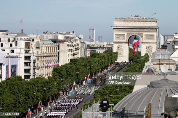 A security officer is seen on a roof top during the annual Bastille Day parade in French capital Paris on July 14 2017 The parade on Paris's...