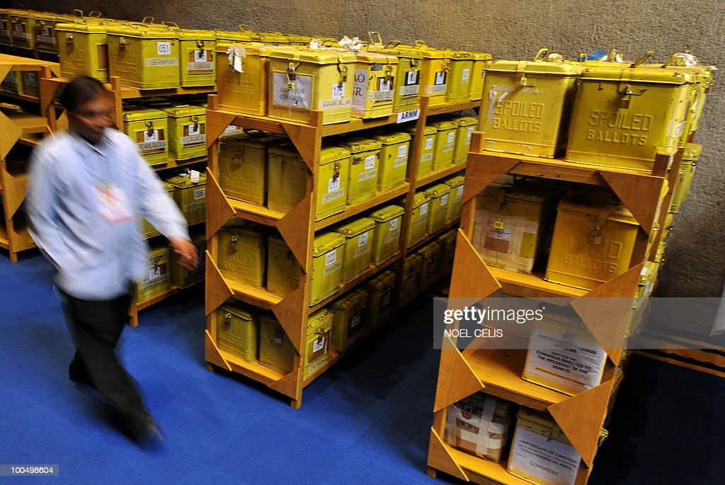 A security officer looks on at the ballot boxes containing the election returns from different clustered precints all over the Philippines for the canvassing of votes for president and vice president at the plenary hall of the Congress in Quezon City, east of Manila on May 25, 2010. President-elect Benigno Aquino, son of recently deceased democracy heroine Corazon Aquino won the May 10 national elections by a landslide after campaigning on pledges to wipe out corruption in the impoverished nation.