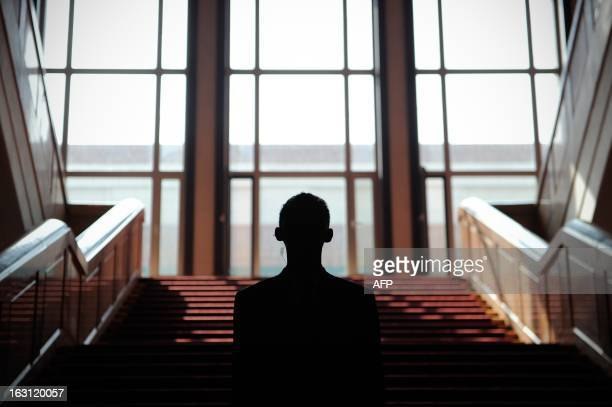 A security officer stands guard at the Great Hall of the People during the opening session of the Chinese National People's Congress in Beijing on...