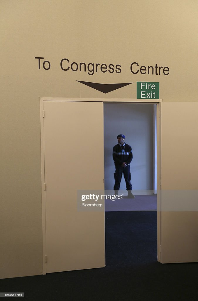 A security officer stands guard inside the media center ahead of The World Economic Forum (WEF) meeting in Davos, Switzerland, on Monday, Jan. 21, 2013. This week the business elite gathers in the Swiss Alps for the 43rd annual meeting of the World Economic Forum in Davos, the five day event runs from Jan. 23-27. Photographer: Simon Dawson/Bloomberg via Getty Images