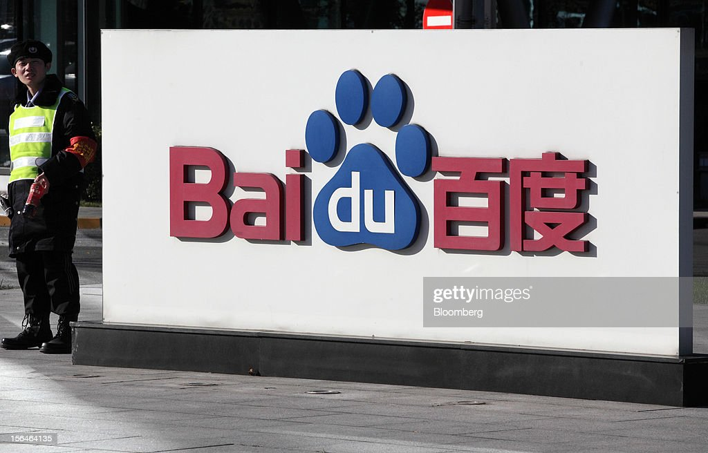 A security officer stands guard near signage displayed outside the Baidu Inc. headquarters in Beijing, China, on Monday, Nov. 12, 2012. Baidu is the owner of China's most-used search-engine. Photographer: Tomohiro Ohsumi/Bloomberg via Getty Images