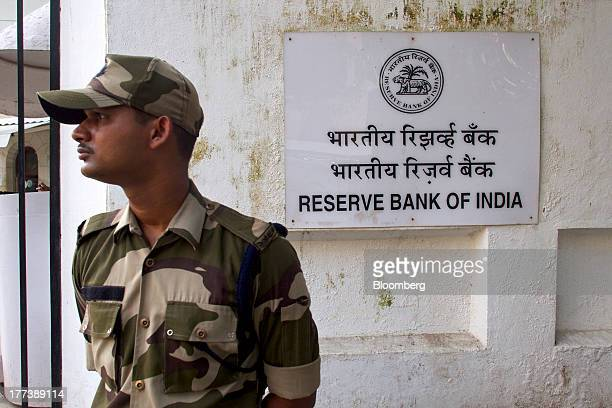 A security officer stands guard outside the Reserve Bank of India headquarters in Mumbai India on Friday Aug 23 2013 Indias rupee plunged 44 percent...