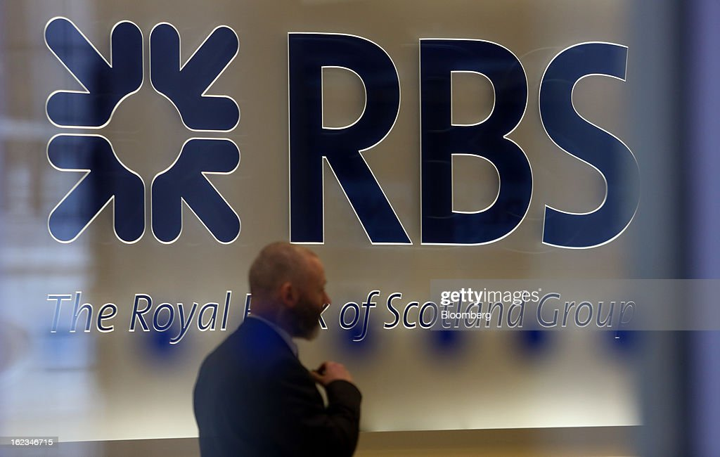 A security officer stands inside the reception area of the headquarters of Royal Bank of Scotland Group Plc (RBS) in London, U.K., on Friday, Feb. 22, 2013. RBS, Britain's biggest publicly owned lender, was fined $612 million by regulators in the U.K. and the U.S. for rigging the London interbank offered rate and similar benchmarks. Photographer: Chris Ratcliffe/Bloomberg via Getty Images