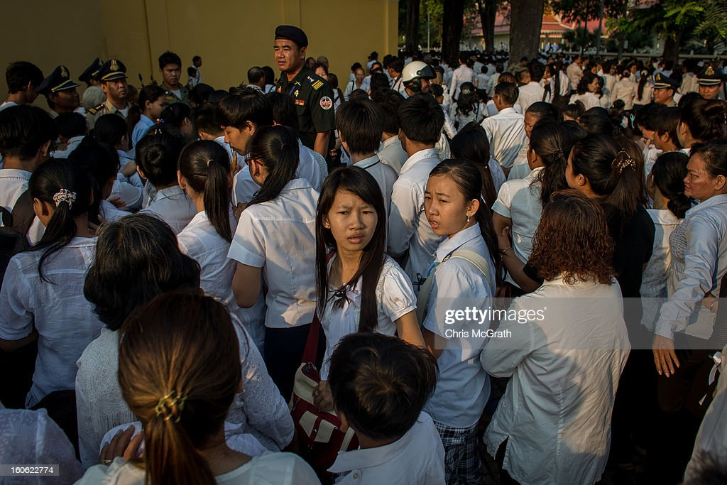 A security officer stands on a barricade and gives instructions as hundreds of mourners try to get to the front of the line to enter the cremation site to pay their final respects to former King Norodom Sihanouk ahead of tonight's cremation on February 4, 2013 in Phnom Penh, Cambodia. The former kings coffin was transported to the cremation site after being paraded through the capital in a lavish funeral procession. The cremation will take place on Monday evening the funeral pyre will be lit by his wife and son King Norodom Sihamoni.