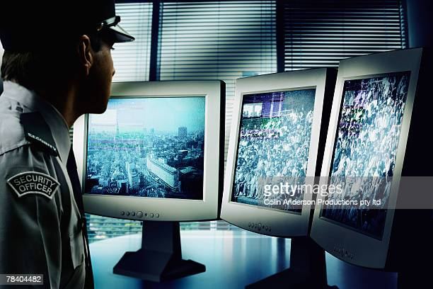 Security officer watching monitors