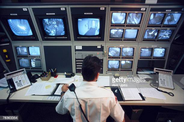 Security officer watching television monitors