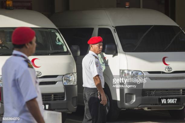 Security officers are seen in front of hospital vans at the Forensic Department of the Putrajaya Hospital outside Kuala Lumpur on February15 2017...